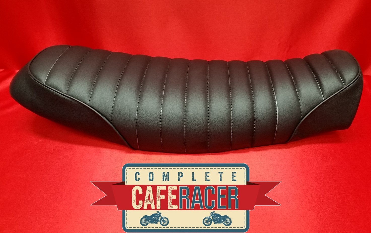 (BS1) BRAT / SCRAMBLER STYLE CAFE RACER SEAT IN BLACK LEATHERETTE (LONGER STYLE SEAT)