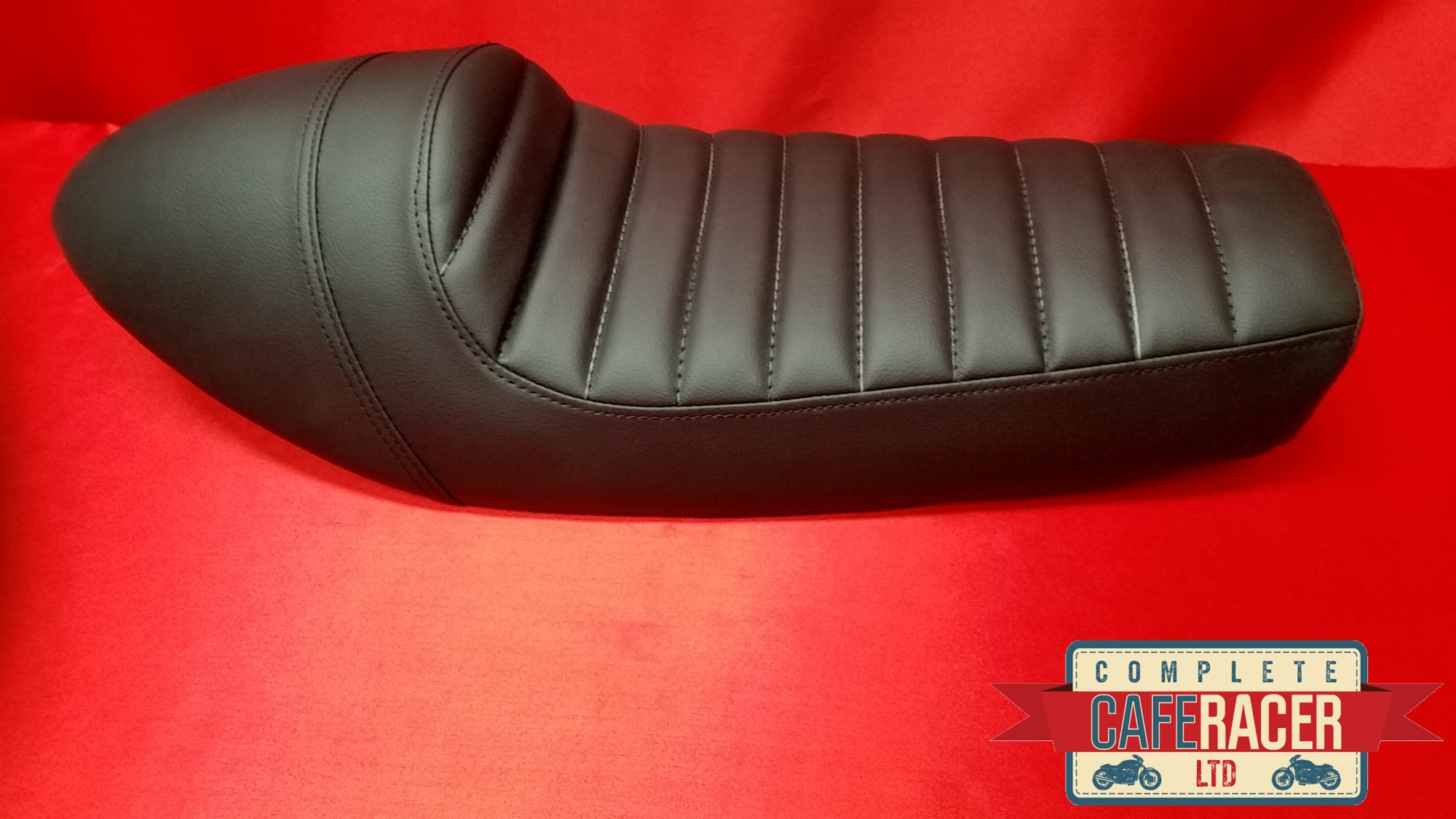 (LS1) CAFE RACER SEAT FINISHED IN BLACK LEATHERETTE SEAT PAD AND HUMP