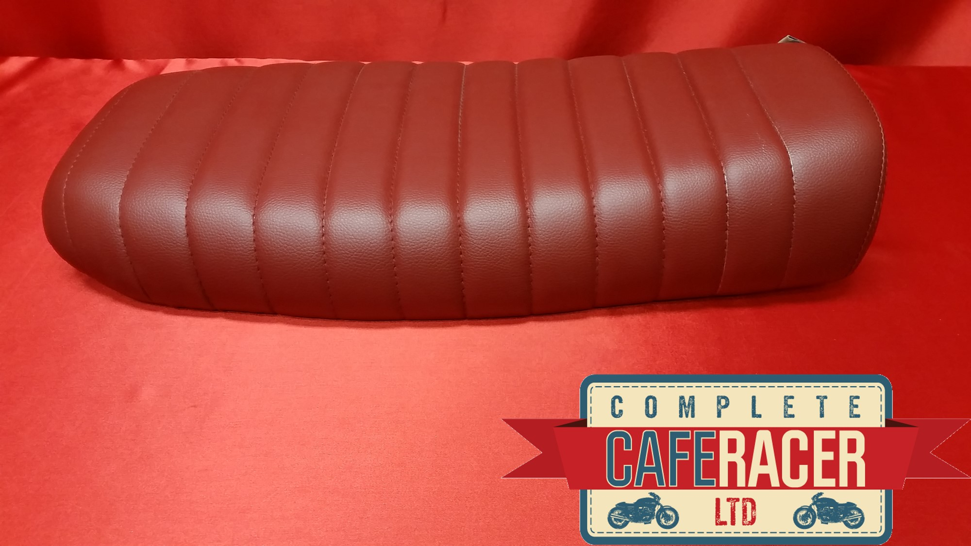 (BS26) BRAT / SCRAMBLER STYLE CAFE RACER SEAT IN DARK RED LEATHERETTE