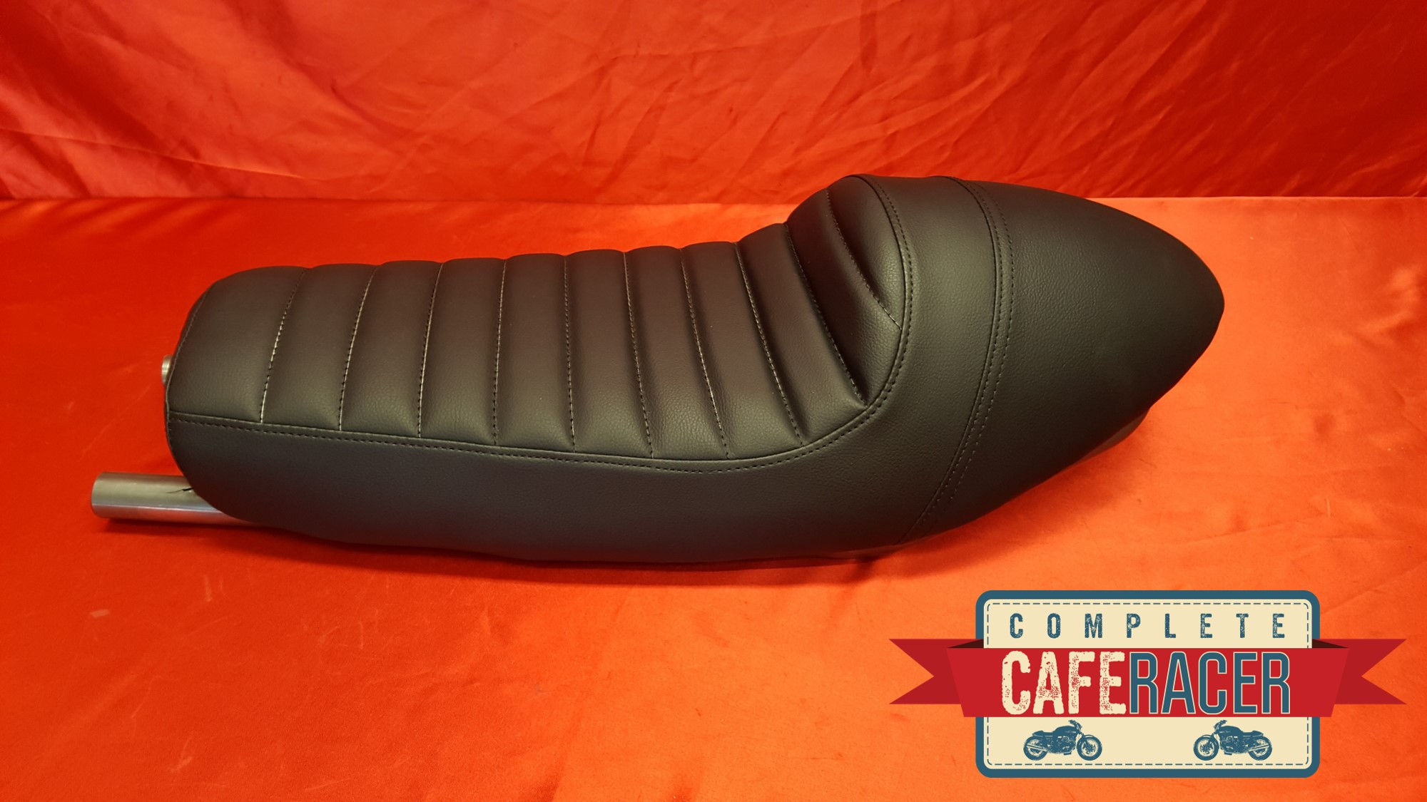 (LS1) CAFE RACER SEAT FINISHED IN BLACK LEATHERETTE SEAT WITH STEEL SEAT HOOP