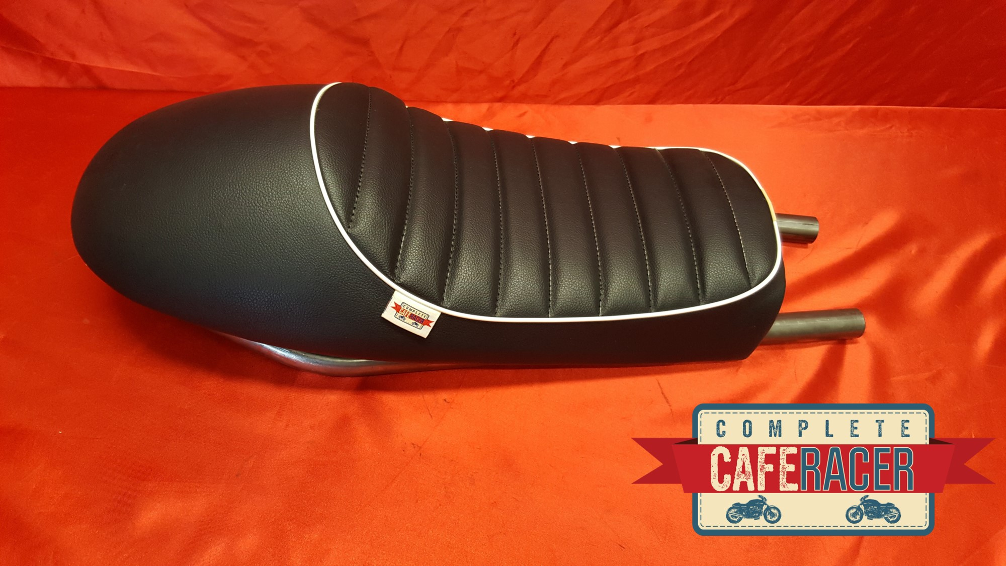 (LS11) CAFE RACER BLACK LEATHERETTE SEAT WITH WHITE PIPING AND STEEL SEAT HOOP